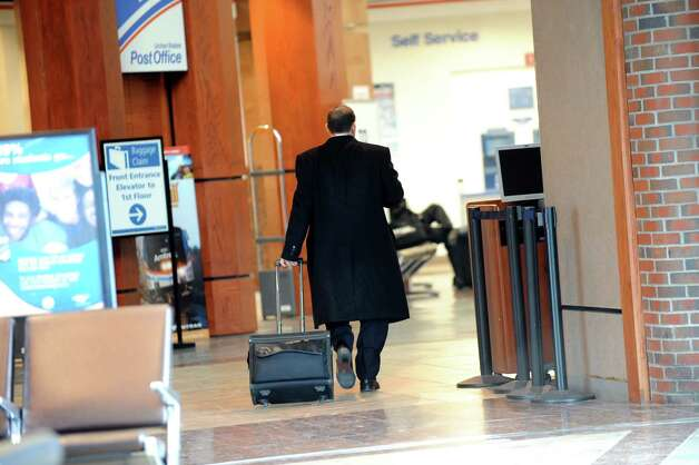 A businessman walks through the station on Tuesday, Jan. 6, 2015, at the Rensselaer Train Station in Rensselaer, N.Y. (Cindy Schultz / Times Union) Photo: Cindy Schultz / 00030093A