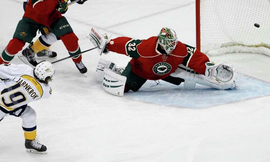 Predators center Calle Jarnkrok scores on Wild goalie Niklas Backstrom to break a third-period tie in St. Paul, Minn. Photo: Ann Heisenfelt / Associated Press / FR13069 AP