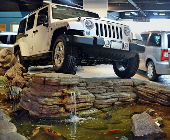 2015 Jeep Wrangler Unlimited Sahara edition inside the showroom at Armory Garage Friday Jan. 9, 2015, in Albany, NY.  (John Carl D'Annibale / Times Union) Photo: John Carl D'Annibale / 00030132C