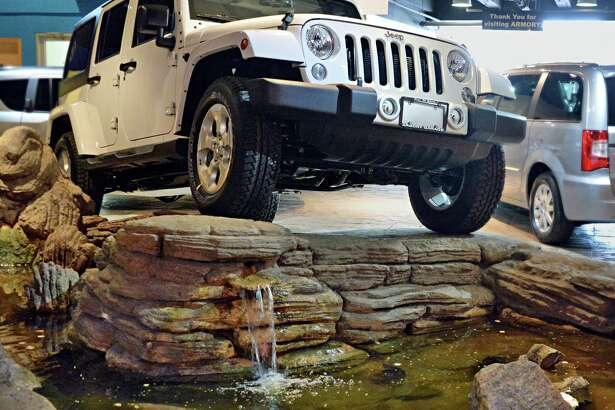 2015 Jeep Wrangler Unlimited Sahara edition inside the showroom at Armory Garage Friday Jan. 9, 2015, in Albany, NY. (John Carl D'Annibale / Times Union)