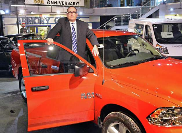 Armory Garage president and CEO Donald Metzner steps up into a 5.7 L V8 equipped 2015 RAM 1500 on his showroom floor Friday Jan. 9, 2015, in Albany, NY.  (John Carl D'Annibale / Times Union) Photo: John Carl D'Annibale / 00030132C
