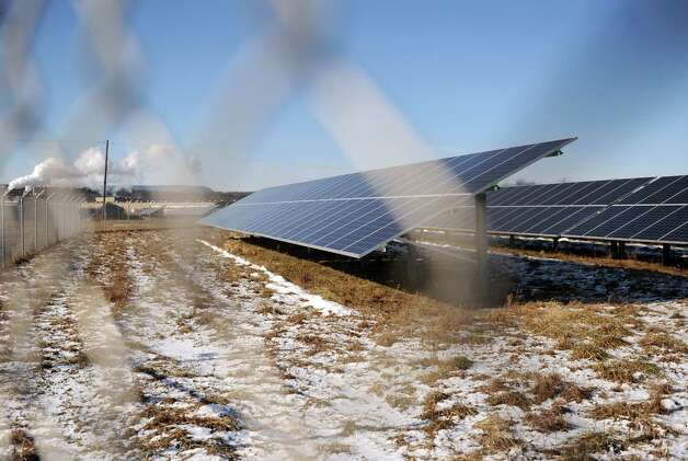 Field of solar panels in the 2.6-megawatt solar farm built in 2013 on Route 32 near the Owens Corning insulation plant Thursday, Jan. 8, 2015, in Selkirk, N.Y. (Michael P. Farrell/Times Union) Photo: Michael P. Farrell / 00030132B