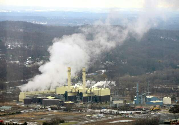Steam and emissions rises from the Empire Generating Co natural gas powered electricity generating plant  Monday afternoon, Dec. 15, 2014, in Rensselaer, N.Y. (Will Waldron/Times Union) Photo: WW