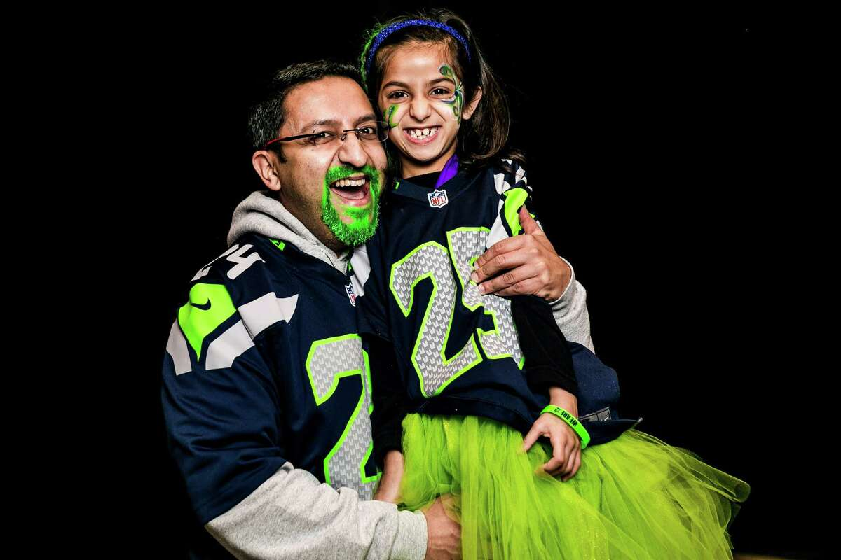 Seattle Seahawks fans show off their playoff pride for their home team before an NFC Divisional Playoff game against the Carolina Panthers on Saturday, January 10, 2015, at CenturyLink Field in Seattle, Washington.