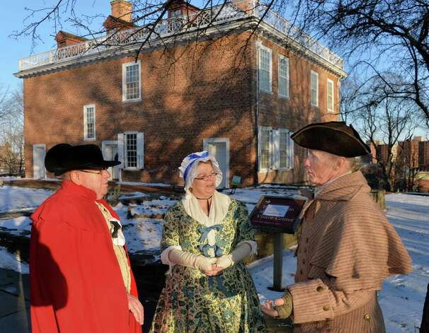 Kevin Richard-Morrow, left, his wife Jennifer of Albany and Olof Jannson, right, of Johnstown arrive dressed in 18C clothing for Twelfth Night festivities at the Schuyler Mansion Saturday Jan. 10, 2015, in Albany, NY.  (John Carl D'Annibale / Times Union) Photo: John Carl D'Annibale / 00030135A