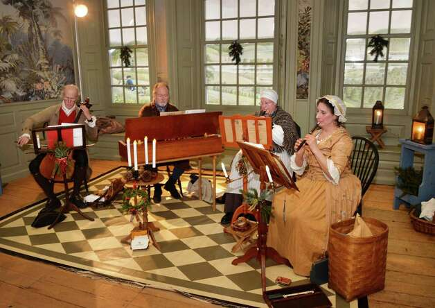 The 18C music ensemble Liaisons Plaisantes performs duringTwelfth Night festivities at the Schuyler Mansion Saturday Jan. 10, 2015, in Albany, NY.  (John Carl D'Annibale / Times Union) Photo: John Carl D'Annibale / 00030135A