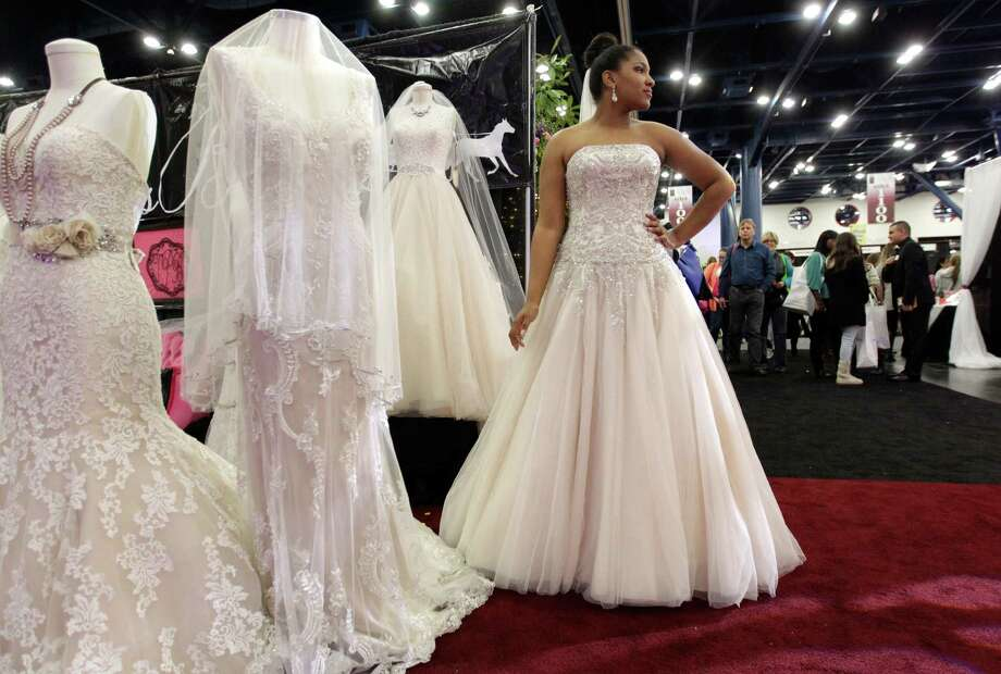 Samantha Hatcher models at The Princess Bridal booth during the Bridal Extravaganza Show held at the George R. Brown Convention Center Saturday, Jan. 10, 2015, in Houston. Photo: Melissa Phillip, Houston Chronicle / © 2014  Houston Chronicle