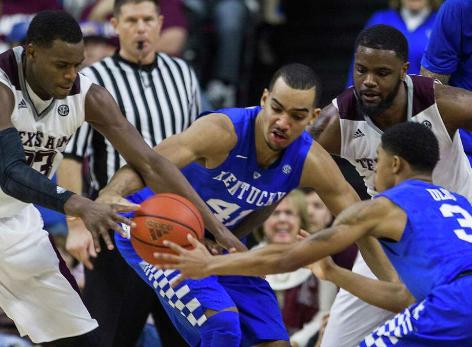 Texas A&M guard Danuel House (23), Kentucky forward Trey Lyles (41) and guard Tyler Ulis (3) fight for a loose ball during the second half of a college basketball game at Reed Arena on Saturday, Jan. 10, 2015, in College Station. ( Brett Coomer / Houston Chronicle ) Photo: Brett Coomer, Houston Chronicle / Houston Chronicle / © 2015 Houston Chronicle
