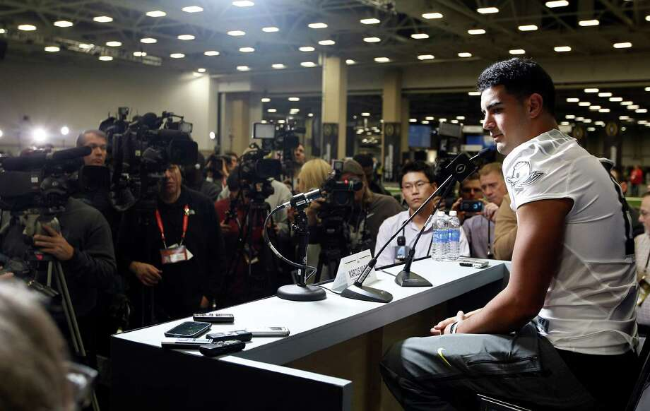 Quarterback Marcus Mariota is the face of Oregon's football program. Photo: Brandon Wade / McClatchy-Tribune News Service / Fort Worth Star-Telegram