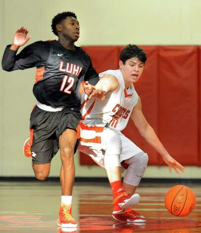 Academy's Will Bennett, right, controls the ball as LuHi's Justin Brown defends during their basketball game on Saturday, Jan. 10, 2015, at Albany Academy in Albany, N.Y. (Cindy Schultz / Times Union) Photo: Cindy Schultz / 00030129A