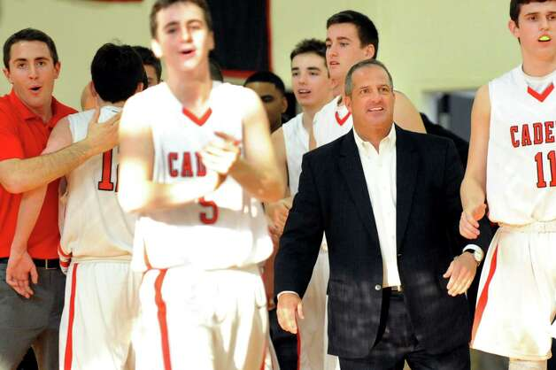 Academy's coach Brian Fruscio, second from right, celebrates with his team when they pull ahead 39-35 in the third quarter during their basketball game against LuHi on Saturday, Jan. 10, 2015, at Albany Academy in Albany, N.Y. (Cindy Schultz / Times Union) Photo: Cindy Schultz / 00030129A