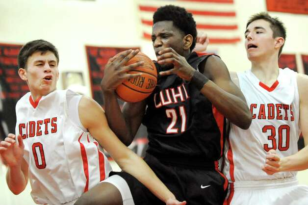 LuHi's Tariq Sadu, center, gets the rebound over Academy's Sal Arena, left, and C.J. Mulvey during their basketball game on Saturday, Jan. 10, 2015, at Albany Academy in Albany, N.Y. (Cindy Schultz / Times Union) Photo: Cindy Schultz / 00030129A