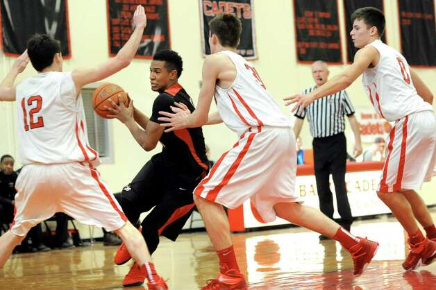 LuHi's Devonte Green, second from left, runs into heavy traffic from Academy's Rory Flaherty, left, C.J. Mulvey, center, and Sal Arena during their basketball game on Saturday, Jan. 10, 2015, at Albany Academy in Albany, N.Y. (Cindy Schultz / Times Union) Photo: Cindy Schultz / 00030129A