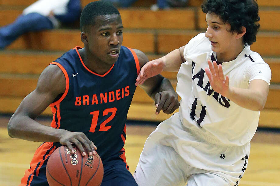 Brandeis guard Ellis Jefferson drives against Marshall's Levi Reed at Taylor Field House on Jan. 10, 2015. Photo: Tom Reel /San Antonio Express-News