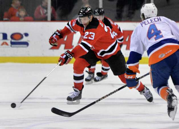 Albany Devils' #23 Darcy Zajac, center, brings the puck down during Saturday's game against Bridgeport Sound Tigers at the Times Union Center Jan. 10, 2015, in Albany, NY.  (John Carl D'Annibale / Times Union) Photo: John Carl D'Annibale / 00030124B