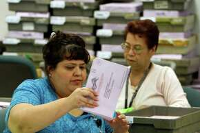 NORWALK,  CA NOVEMBER 4, 2010: Alice Cumplido, a clerk, sorts vote by mail ballots in preparation for Friday's vote tally at the Los Angeles County Registrar's office in Norwalk. The race for California Attorney General will come down to a tally of vote by mail votes as Kamala Harris leads Steve Cooley by a slim margin. ( Allen J. Schaben / Los Angeles Times )