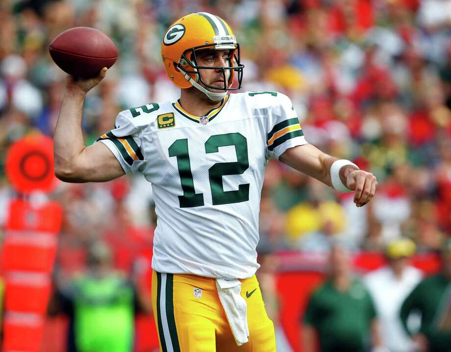 Green Bay Packers quarterback Aaron Rodgers won't enter Sunday's Playoff game vs. the Cowboys at 100 percent. Photo: Jeff Haynes /Associated Press / FR171008 AP