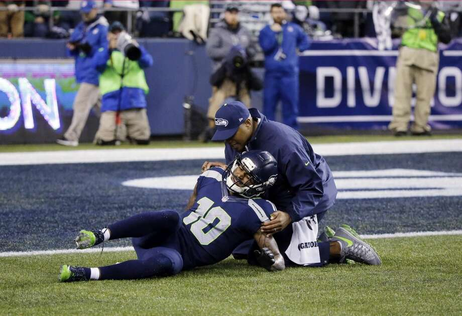 Seattle Seahawks wide receiver Paul Richardson (10) lays on the ground after being injured against the Carolina Panthers during the second half of an NFL divisional playoff football game in Seattle, Saturday, Jan. 10, 2015. (AP Photo/Ted S. Warren) Photo: AP