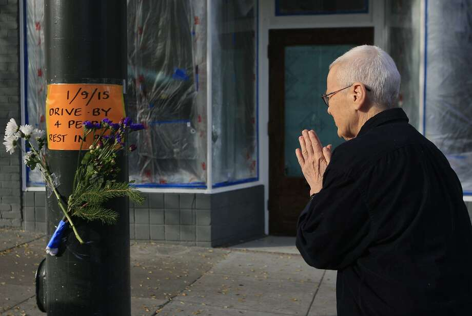 Kogan Sheldon of San Francisco's Zen Center pays her respects at a memorial set up Saturday, January 10, 2015 at Laguna and Page streets in San Francisco, Calif. where a quadruple homicide occurred 10 p.m. Friday night. Photo: Jessica Christian, Special To The Chronicle