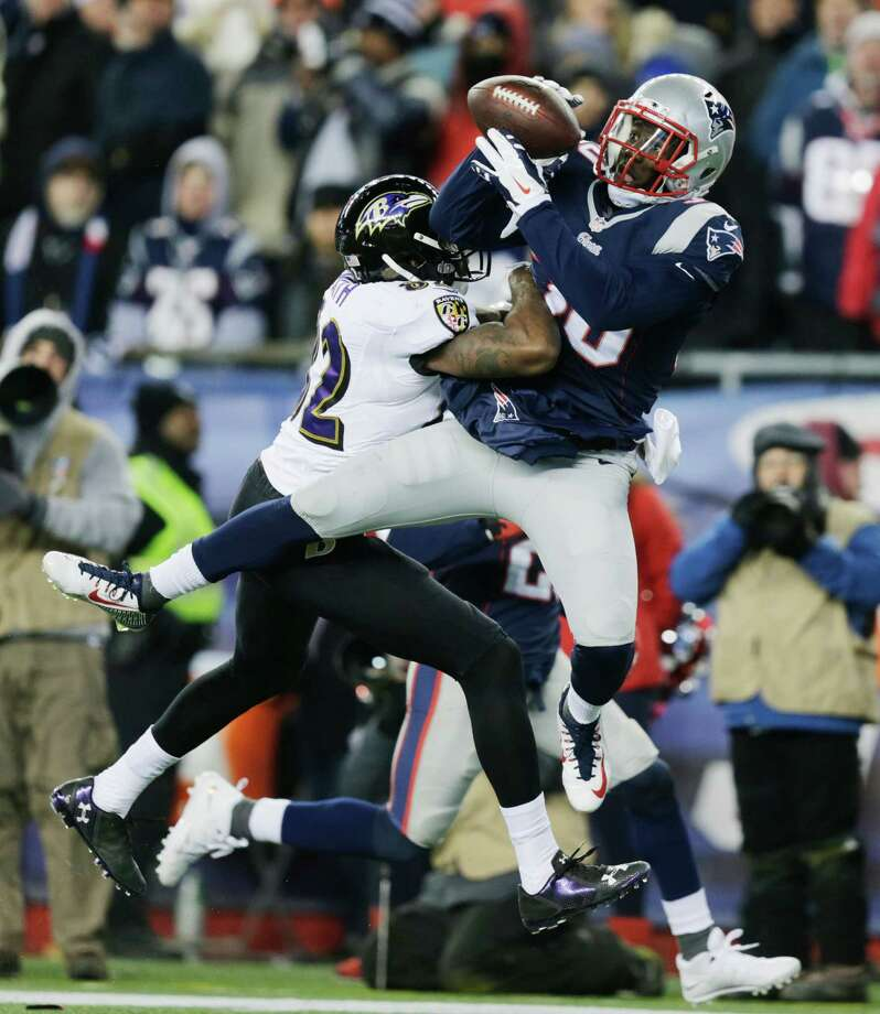 New England Patriots strong safety Duron Harmon (30) intercepts a pass by Baltimore Ravens quarterback Joe Flacco in front of Baltimore Ravens wide receiver Torrey Smith (82) in the second half of an NFL divisional playoff football game Saturday, Jan. 10, 2015, in Foxborough, Mass.  (AP Photo/Charles Krupa) Photo: Charles Krupa / Associated Press / AP