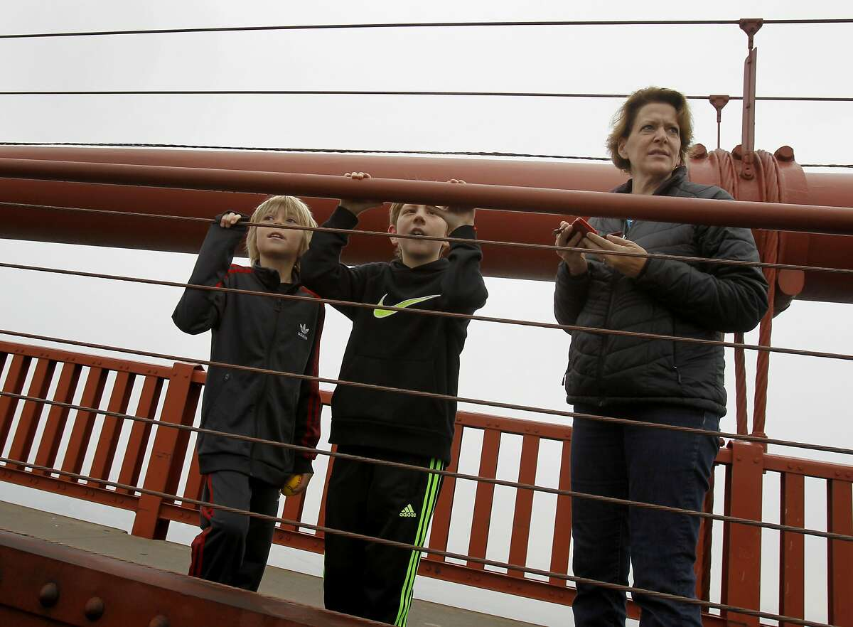 Pedestrians and cyclists flocked to the east side of the walkway to view the new barrier Sunday January 11, 2015. Crews on the Golden Gate Bridge practiced with