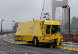 "A zipper truck rearranged the barrier on the north side of the bridge Sunday January 11, 2015. Crews on the Golden Gate Bridge practiced with ""zipper"" trucks on their new moveable median barrier to get ready to reopen the span Monday morning."