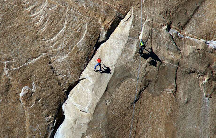 In this Dec. 28, 2014 photo provided by Tom Evans, Tommy Caldwell ascends what is known as pitch 10 on what has been called the hardest rock climb in the world: a free climb of a El Capitan, the largest monolith of granite in the world, a half-mile section of exposed granite in California's Yosemite National Park. (AP Photo/Tom Evans, elcapreport) Photo: Tom Evans / Associated Press / Tom Evans, elcapreport