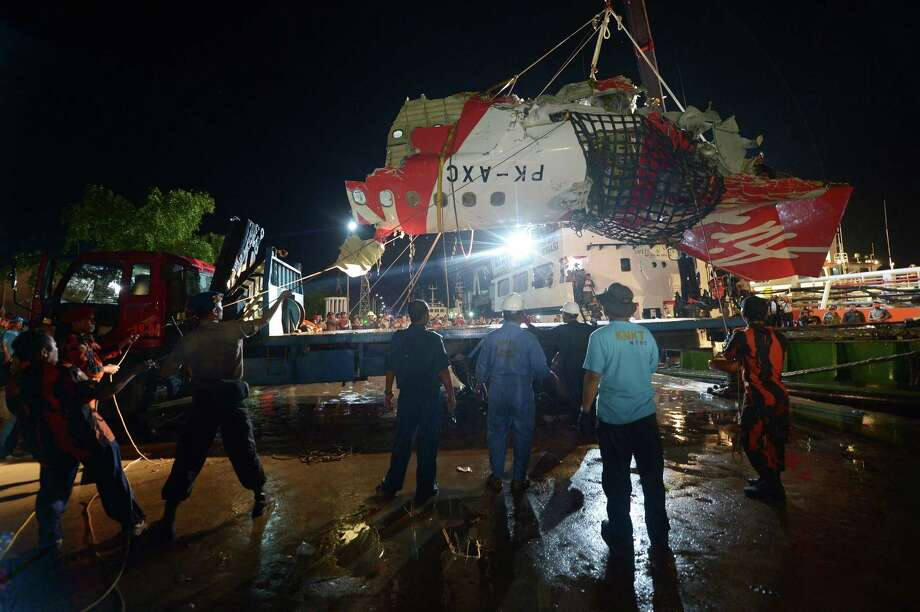 The tail section of the AirAsia jet that crashed Dec. 28 is loaded onto a truck in Kumai after being recovered from the Java Sea on Saturday. Photo: ADEK BERRY / AFP/Getty Images / AFP