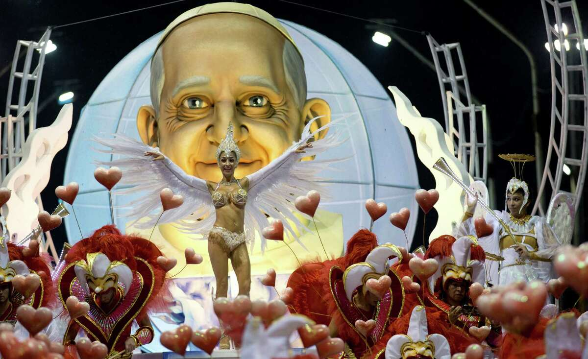 The Ara Yevi samba school performs with a float showcasing Pope Francis, their homage to the Argentine-born pontiff during carnival celebrations in Gualeguaychu, Argentina, early Sunday, Jan. 11, 2015. The group is performing with two other schools during the carnival that continues throughout Feb. 28.