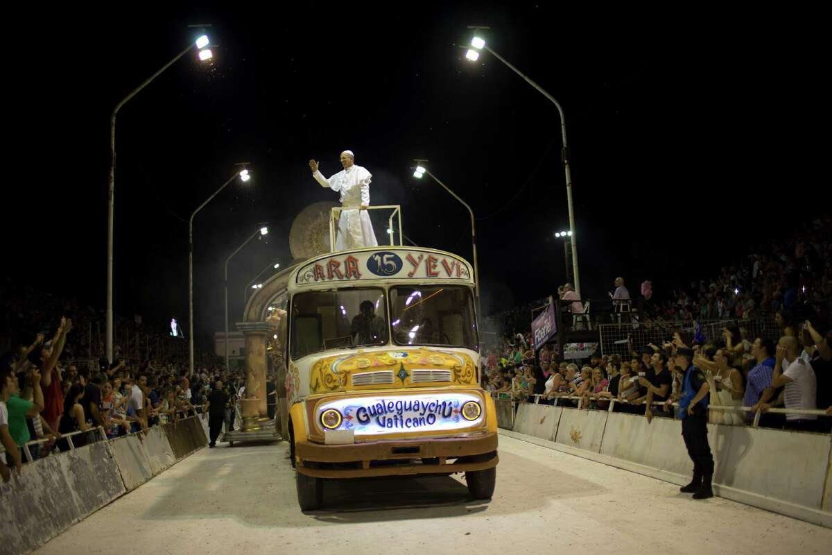 Roman Figun, a local lawyer, performs the role of Pope Francis with the Ara Yevi samba school as he stands on a bus representing his humble arrival to the Vatican during carnival celebrations in Gualeguaychu, Argentina, early Sunday, Jan. 11, 2015. Ara Yevi, one of the three samba schools performing this year, used Pope Francis as their central theme. Figun says he does his best to play the Pope and his carnival group wants to spread his message.