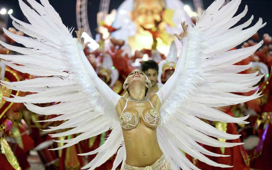 "A dancer with the Ara Yevi samba school performs during a carnival parade that pays tribute to Pope Francis in Gualeguaychu, Argentina, early Sunday, Jan. 11, 2015. The troupe's main song says : ""We're the power of a revolution, let's make noise, it's carnival,"" quoting the Argentine Pontiff's famous call to ""make noise"" to the crowd during his 2013 visit to Brazil. Photo: Natacha Pisarenko, AP / AP"