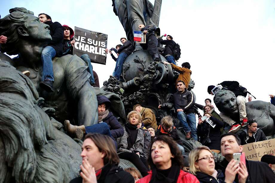 People gather at Place de la Nation during a rally in Paris, Sunday, Jan. 11, 2015. Hundreds of thousands gathered Sunday throughout Paris and cities around the world, to show unity and defiance in the face of terrorism that killed 17 people in France's bleakest moment in half a century. (AP Photo/Thibault Camus) Photo: Thibault Camus, Associated Press