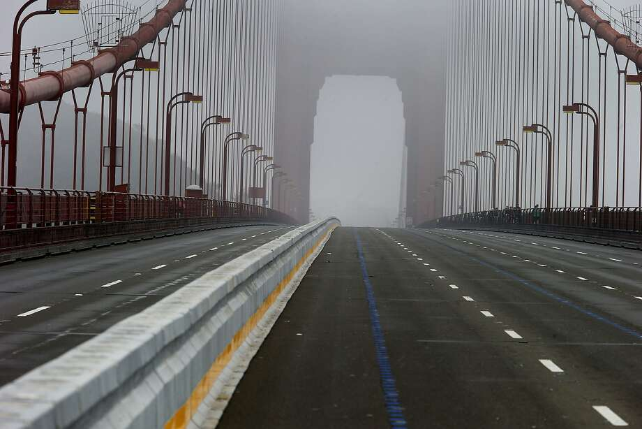 "A view of the new barrier looking northbound in the fog Sunday January 11, 2015. Crews on the Golden Gate Bridge practiced with ""zipper"" trucks on their new moveable median barrier to get ready to reopen the span Monday morning and then held a ribbon cutting ceremony at the northern vista point. Photo: Brant Ward, The Chronicle"