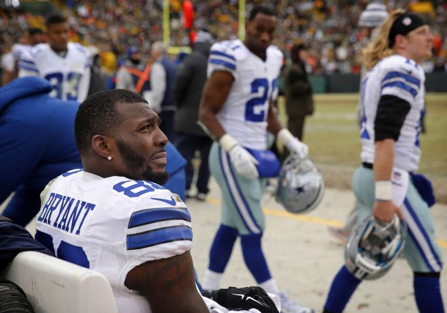 Dallas Cowboys wide receiver Dez Bryant (88) sits alone on the bench as the remaining seconds tick off the clock during the loss to the Green Bay Packers in the NFC Divisional playoff at Lambeau Field in Green Bay Wisconsin, Sunday, January 11, 2015. The Cowboys lost 26-21. (Tom Fox/The Dallas Morning News) Photo: Staff Photographer