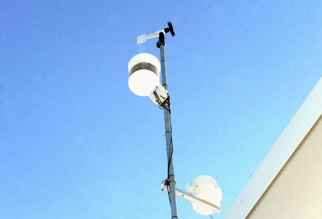 The WeatherBug monitor perched on the roof of Gordon Creek Elementary School  Wednesday Jan. 7, 2015 in Ballston Spa, N.Y. (Michael P. Farrell/Times Union) Photo: Michael P. Farrell / 00030110A