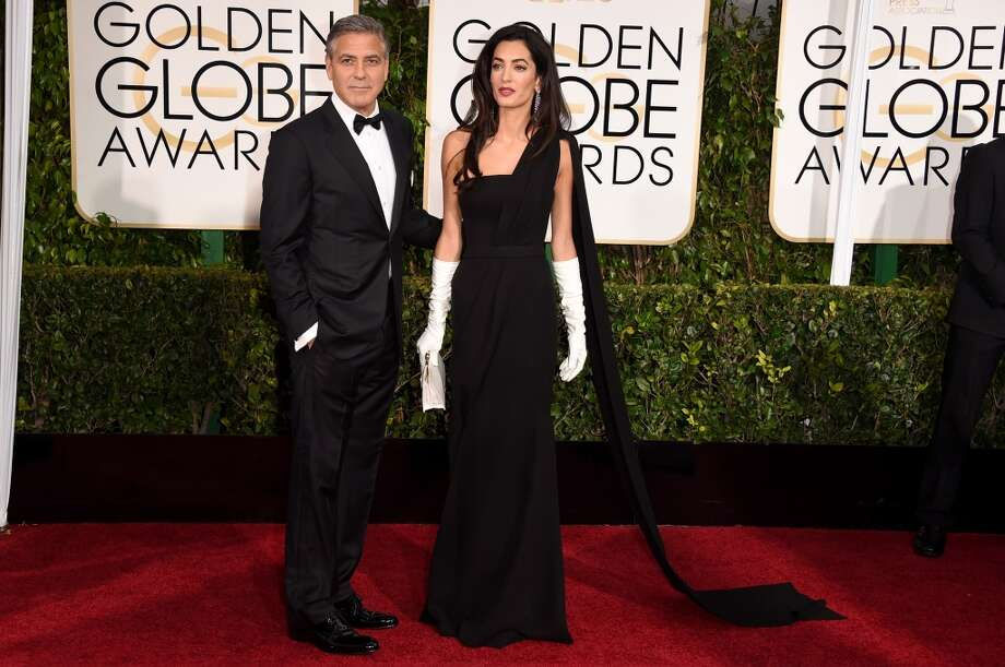 Actor George Clooney (L) and  lawyer Amal Clooney attend the 72nd Annual Golden Globe Awards at The Beverly Hilton Hotel on January 11, 2015 in Beverly Hills, California.  (Photo by Jason Merritt/Getty Images) Photo: Jason Merritt, Getty Images