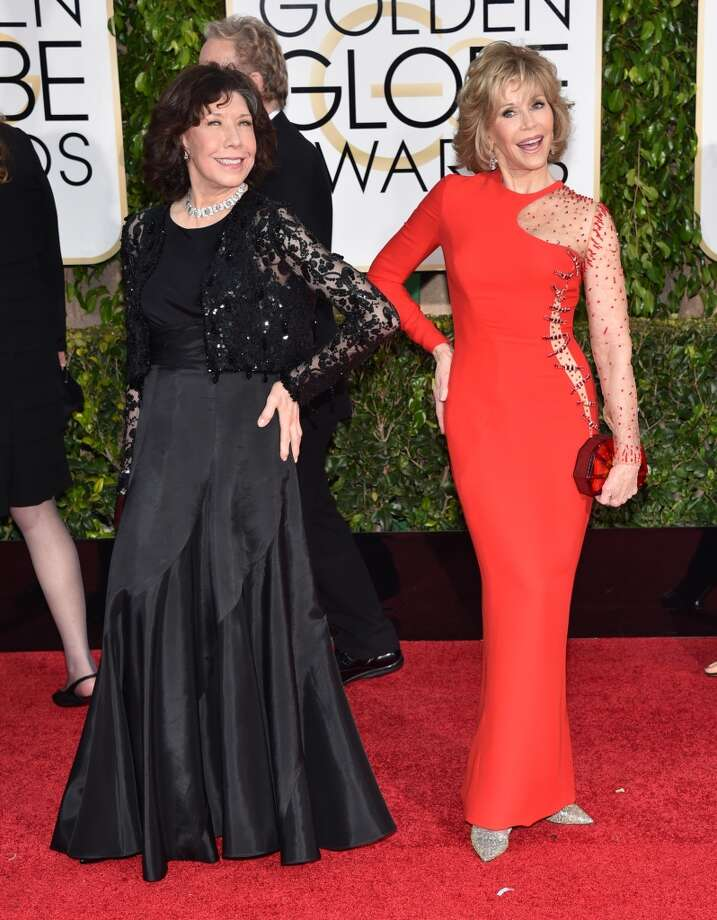 Paging Elizabeth Hurley: At 77, fabulous Jane Fonda (right) should be wise enough not to embrace Versace's signature safety pin style.  Photo: John Shearer, Associated Press