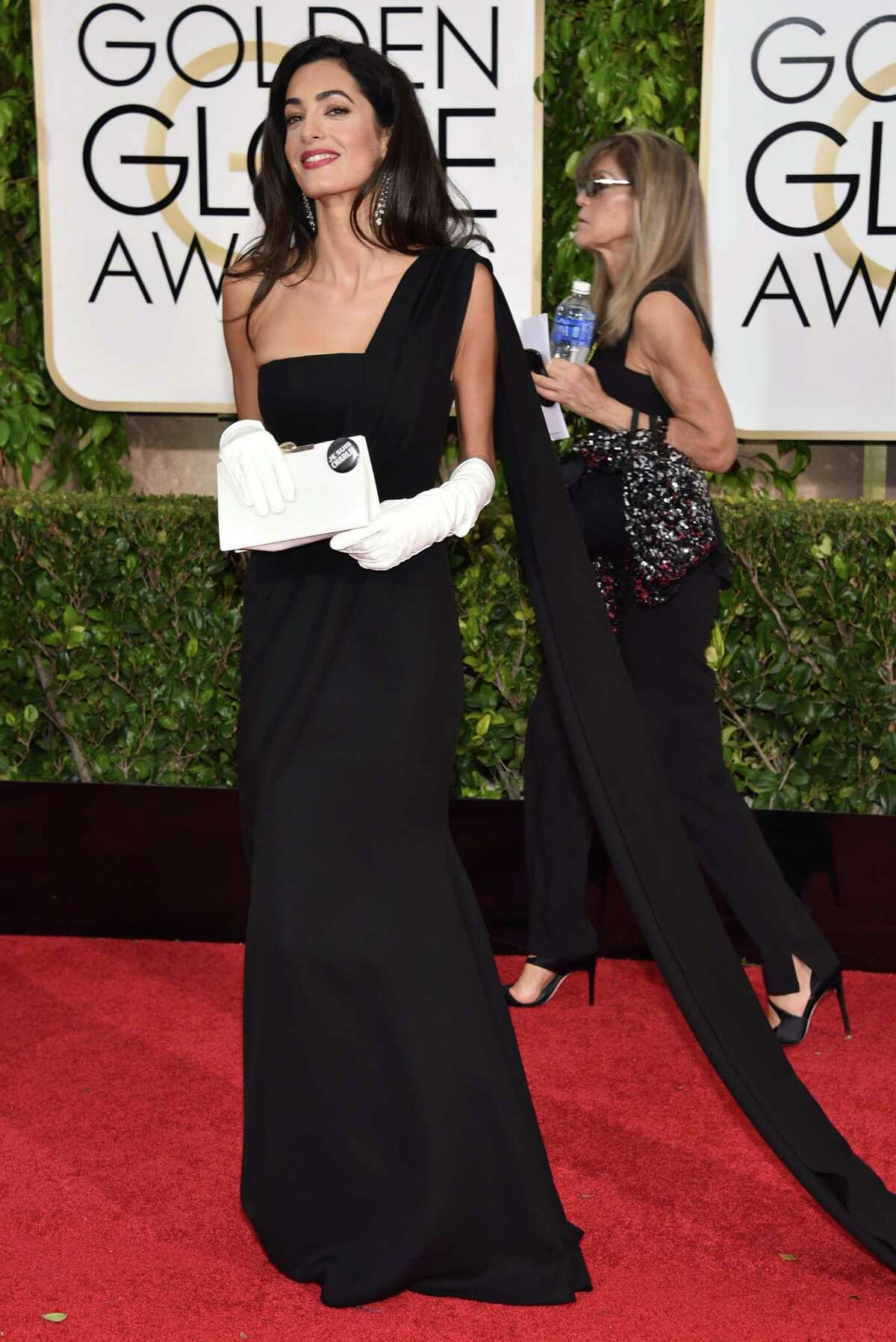Amal Clooney arrives at the 72nd annual Golden Globe Awards at the Beverly Hilton Hotel on Sunday, Jan. 11, 2015, in Beverly Hills, Calif. (Photo by John Shearer/Invision/AP)