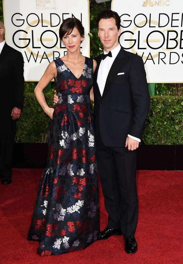 Perfect pair: Mom-to-be Sophie Hunter bloomed in floral jacquard with red lips to match, while fiance and Benedict Cumberbatch buttoned up in a timeless tux. Photo: Jordan Strauss, AP Photo / Invision