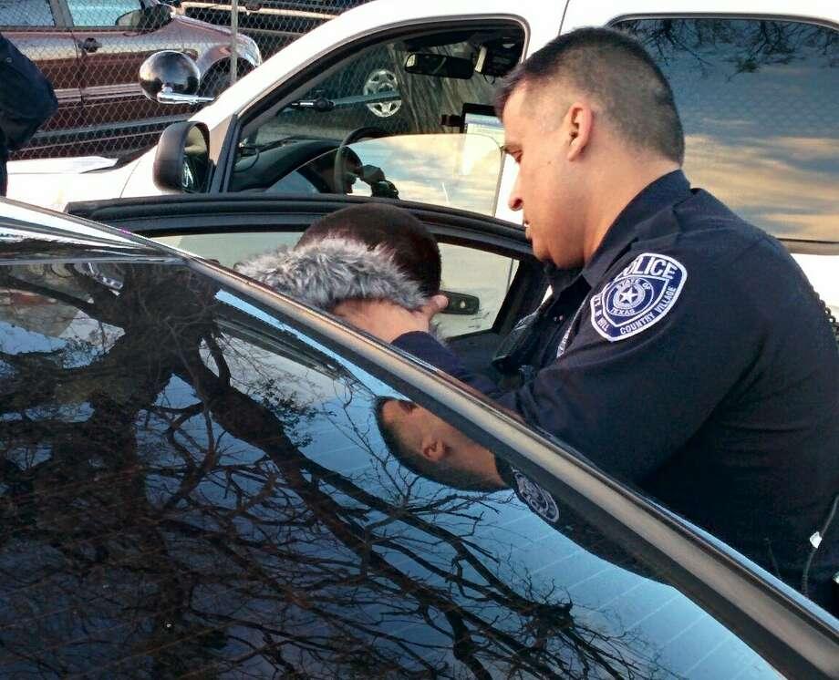 Police take a suspect into custody following a car chase. Photo: By Jacob Beltran, San Antonio Express-News