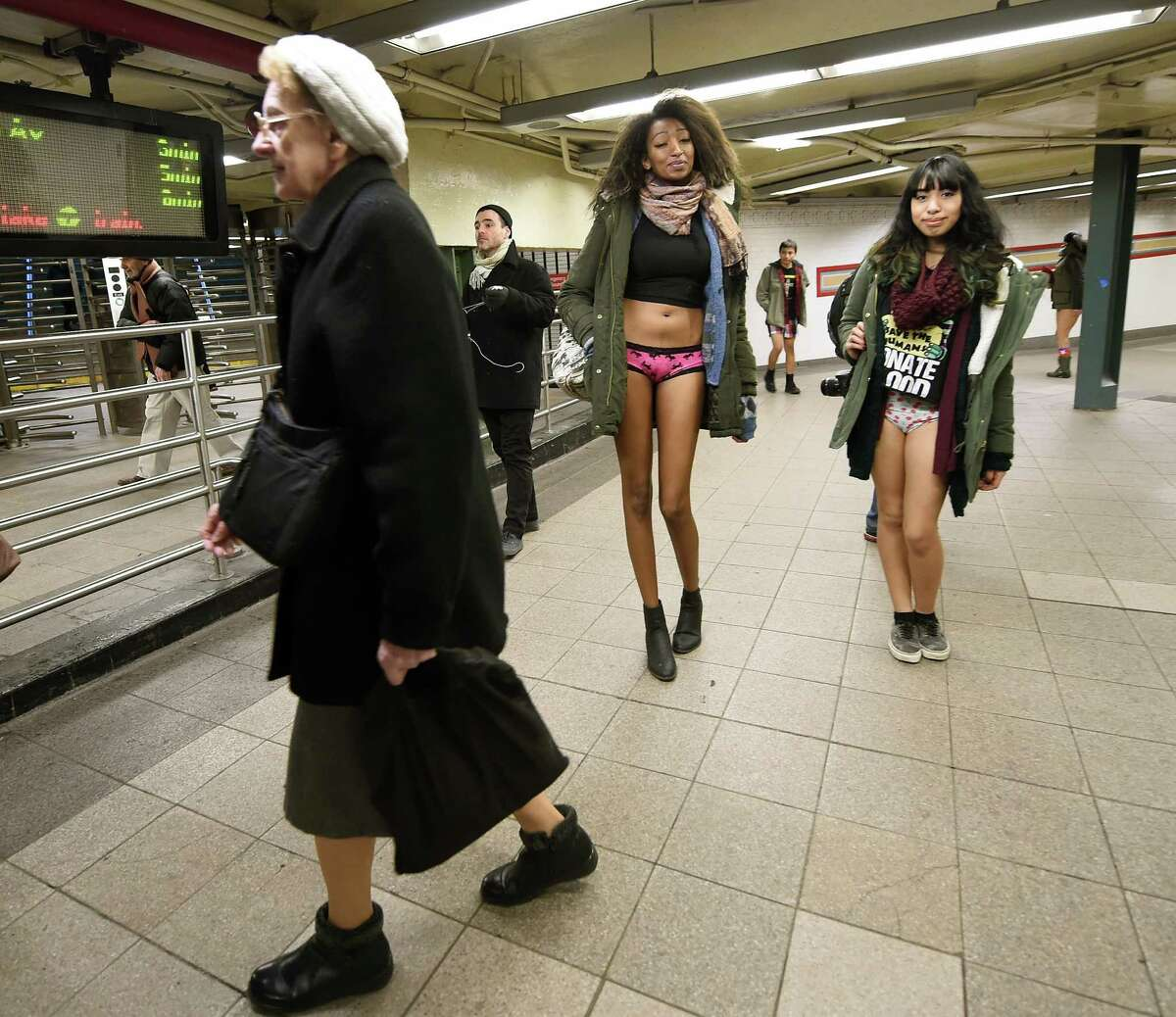 Some participants in their underwear take part in the No Pants Subway Ride in New York subway on January 11, 2015 in New York. The No Pants Subway Ride is an annual which was started in 2002 by Improv Everywhere in New York, the goal is for riders to get on the subway train dressed in normal winter clothes without pants and keep a straight face. AFP PHOTO / TIMOTHY A. CLARY