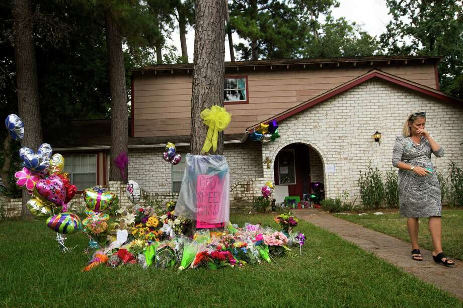 An impromptu memorial outside the house of the Stay family in Spring, Texas. Last year, six people, including four children, were shot and killed there. Photo: Brett Coomer, Staff / © 2014 Houston Chronicle