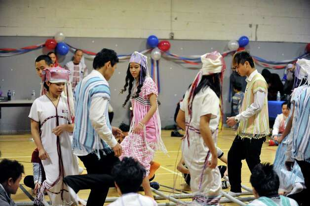 Members of the Albany Karen Youth Group perform a traditional bamboo dance during a celebration of the Karen New Year at the Albany Boys and Girls Club on Sunday, Jan. 11, 2015, in Albany, N.Y.  The day was filled with traditional music and dance along with talks about the Karen culture and history.  (Paul Buckowski / Times Union) Photo: Paul Buckowski / 00030098A