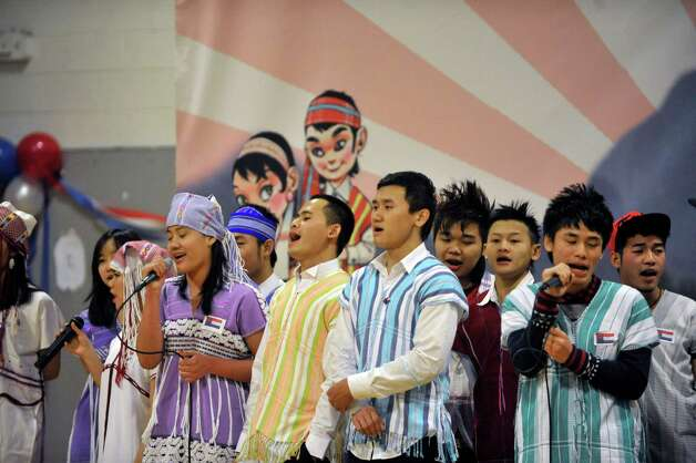 A group of Karen youth perform a song during a celebration of the Karen New Year at the Albany Boys and Girls Club on Sunday, Jan. 11, 2015, in Albany, N.Y.  The day was filled with traditional music and dance along with talks about the Karen culture and history.  (Paul Buckowski / Times Union) Photo: Paul Buckowski / 00030098A