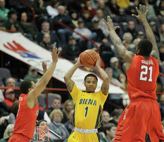 Marquis Wright of Siena, center, looks for a teammate to pass off to as heOs pressured by defenders during their game against Fairfield at the Times Union Center on Sunday, Jan. 11, 2015, in Albany, N.Y.   (Paul Buckowski / Times Union) Photo: Paul Buckowski / 00030029C