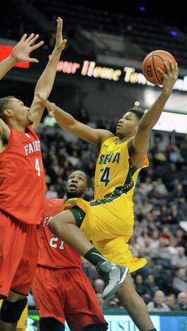 Lavon Long of Siena, right, drives to the basket during their game against Fairfield at the Times Union Center on Sunday, Jan. 11, 2015, in Albany, N.Y.   (Paul Buckowski / Times Union) Photo: Paul Buckowski / 00030029C