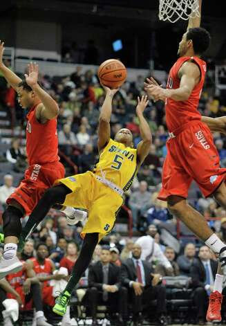 Evan Hymes of Siena, center, puts up a shot after driving to the basket during their game against Fairfield at the Times Union Center on Sunday, Jan. 11, 2015, in Albany, N.Y.   (Paul Buckowski / Times Union) Photo: Paul Buckowski / 00030029C