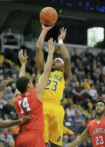 Maurice White of Siena, right, takes a jump shot during their game against Fairfield at the Times Union Center on Sunday, Jan. 11, 2015, in Albany, N.Y.   (Paul Buckowski / Times Union) Photo: Paul Buckowski / 00030029C