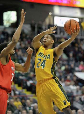 Lavon Long of Siena, right, puts up a shot during their game against Fairfield at the Times Union Center on Sunday, Jan. 11, 2015, in Albany, N.Y.   (Paul Buckowski / Times Union) Photo: Paul Buckowski / 00030029C