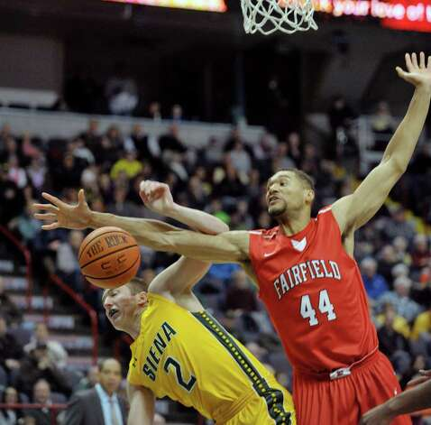 Willem Brandwijk of Siena, left, and Malcolm Gilbert of Fairfield battle for a rebound during their game at the Times Union Center on Sunday, Jan. 11, 2015, in Albany, N.Y.   (Paul Buckowski / Times Union) Photo: Paul Buckowski / 00030029C